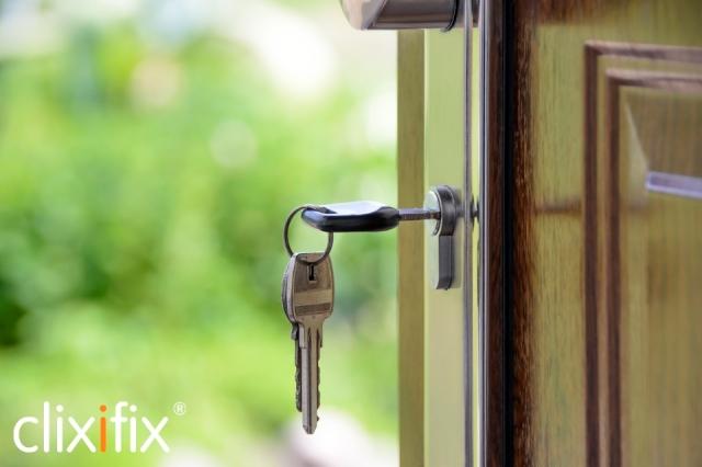 keys in door with logo
